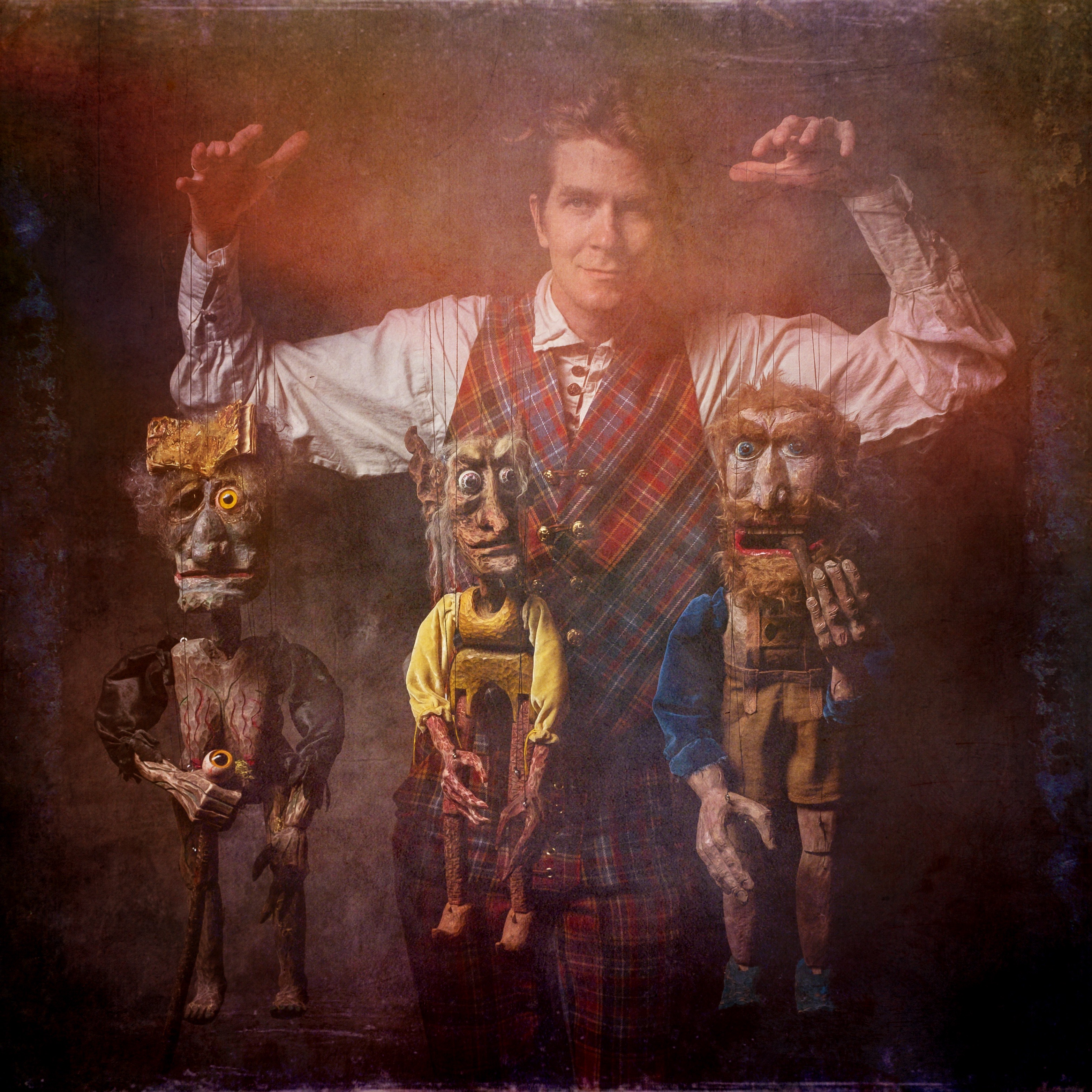 Storyteller-and-puppeteer-Dalrymple-MacAlpin-with-three-marionettes